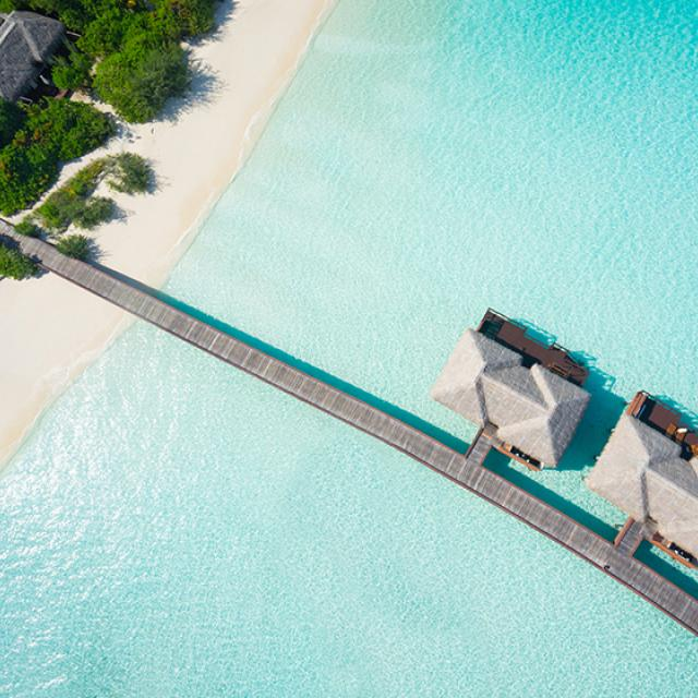 Overwater villas in tropical lagoon